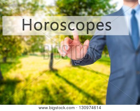 Horoscopes - Businessman Hand Pressing Button On Touch Screen Interface.