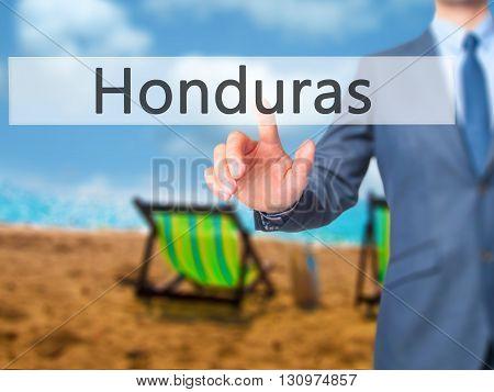 Honduras - Businessman Hand Pressing Button On Touch Screen Interface.