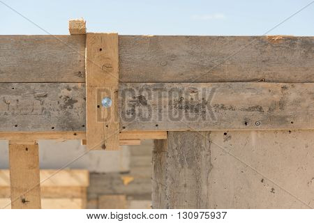 Concrete doorway in building house with wooden elements