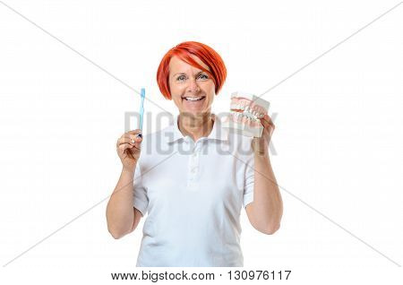 Woman Holding Toothbrush And Mouth Model