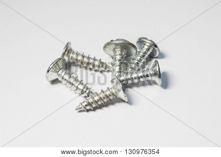 Screws for industry and manufacturing with white, grey background