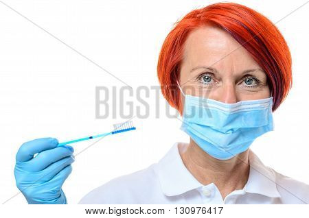 Dental Hygienist In Red Hair With Toothbrush