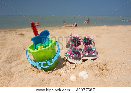 Toys for children sandboxes against the sea