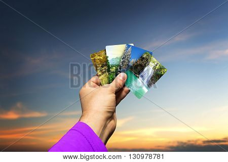 Male hand holding seasons cards