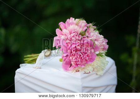 Beautiful wedding bouquet of pink peons, close up