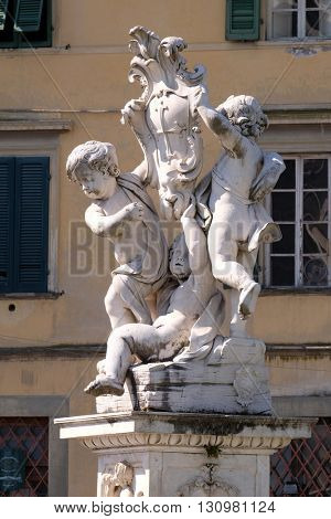 PISA, ITALY - JUNE 06, 2015: PISA, ITALY - JUNE 06, 2015: Fontana dei Putti on Piazza dei Miracoli with Angels in Pisa, Italy in Pisa, Italy, on June 06, 2015
