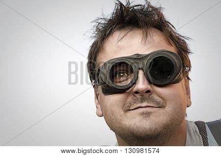 Portrait of a man steampunk on light grey background