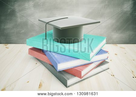 Book and graduation cap on wooden desktop with chalkboard in the background. Education concept. 3D Rendering