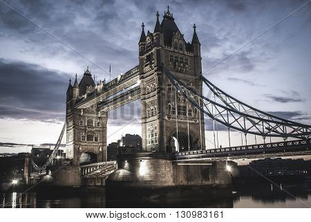 Tower Bridge and calm river Thames before sunset.