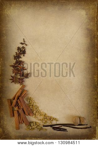 Herbs and lavender twigs lying on a textured grunge background