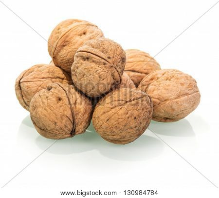 Much of whole walnuts isolated on white background.