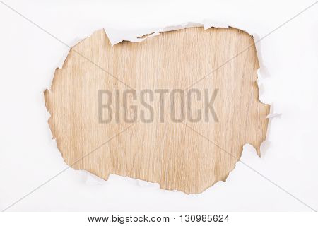 Torn white paper revealing wooden surface. Mock up