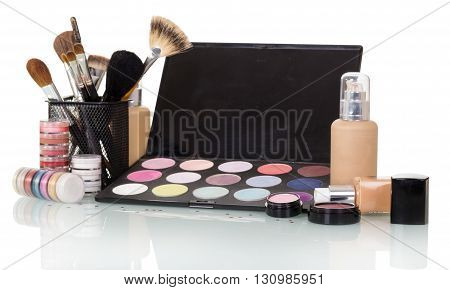 A set of professional cosmetics and makeup brushes isolated on white background.