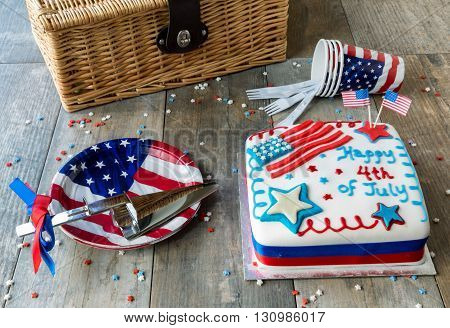 4th of July celebration cake with plates, cups and picnic hamper