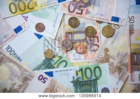 Photo Paper euro banknotes and euro coins