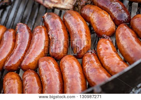 BBQ with fiery group of sausages on the grill