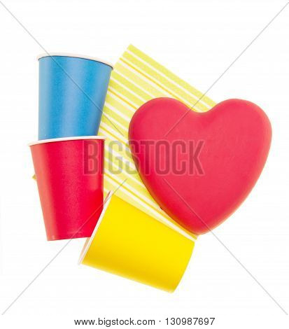 Bright disposable cups and napkin isolated on a white background.