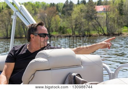 men pointing finger at something on a boat