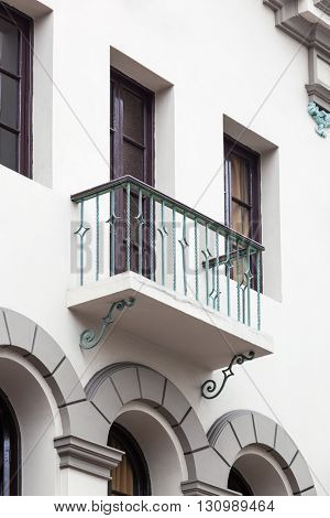 beautiful balcony with a window on white building