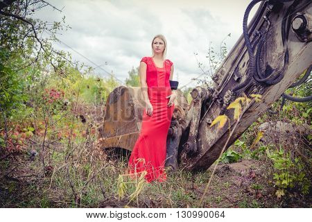 blond girl in a beautiful red dress, style