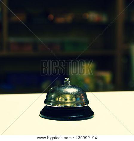 Receptionist bell. Blurred background reception or restaurant.