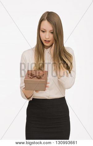 Young woman portrait receiving gift from someone