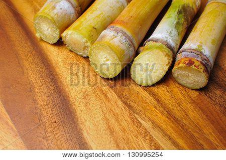 Sugar Cane On Wood Background