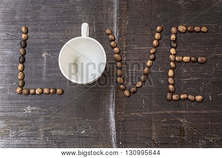 LOVE coffee beans on wooden background. Top View