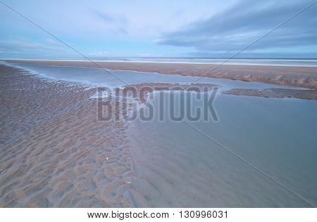 North sea coast at low tide North Holland Netherlands