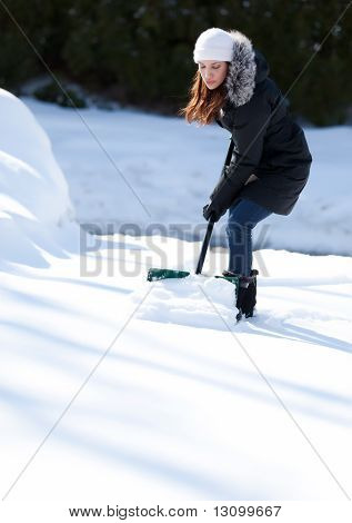Woman Working Hard To Shovel Snow