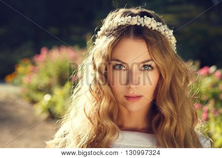 Lovely Bride with Wedding Tiara on Nature Background. Modern Fashion Bridal Style. Toned Photo with Copy Space.