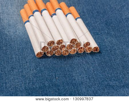 Closeup to jeans pocket with cigarettes. Cigarettes in blue denim