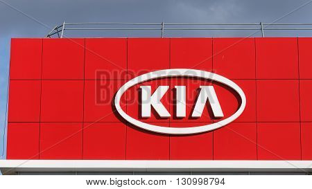 Kia Sign On Building Kia Selling And Service Center.