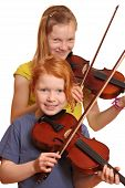 stock photo of string instrument  - Two happy girls with violins isolated on white background - JPG