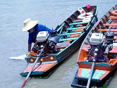 foto of outboard engine  - two traditional wooden boats with outboard engines on the chao praya river in bangkok - JPG