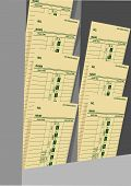 image of payroll  - Time cards in a rack for business payroll to pay day hourly wage job - JPG