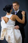 stock photo of semi-formal  - Young couple dressed in elegant clothes - JPG