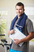 pic of personal trainer  - Handsome personal trainer with training plan - JPG