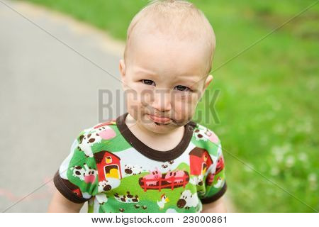 Child With Dirty Funny Face  Outdoor At Playground.