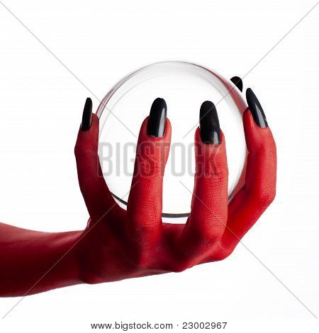 Devil's hand holding crystal ball.