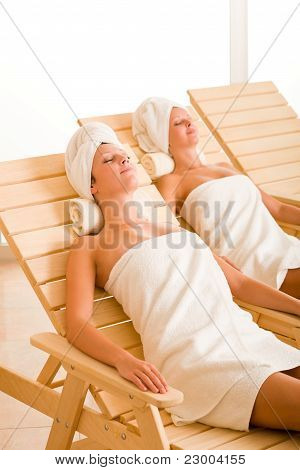 Beauty Spa Room Two Women Relax Sun-beds
