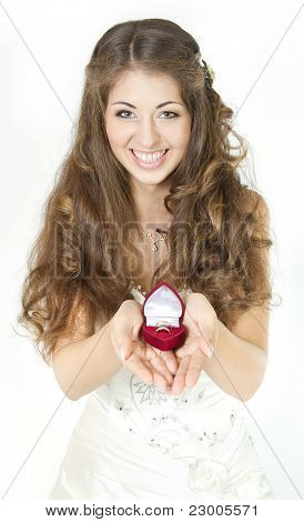 Bride Holding Red Box With Golden Wedding Rings. Smiling And Looking At Camera. Over White....