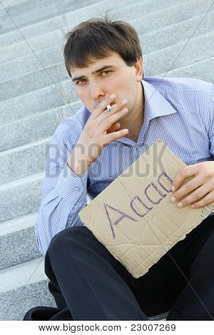 Businessman smokes
