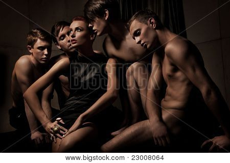 Sexy woman among group of man
