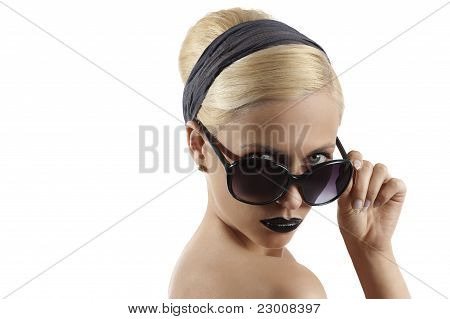Fashion Shot Of Blond Girl With Sunglasses Posing Against White Background
