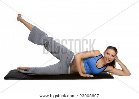 Isolated fitness mat woman exercising