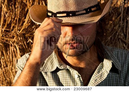 Cowboy Holding His Hat