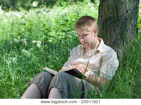 The young man with the book in park
