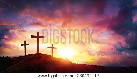 crucifixion of jesus christ at sunrise three crosses on hill