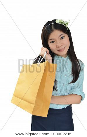 Asian Woman Smiling And Holding Shopping Bag
